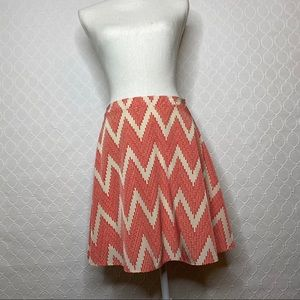 Francesca's Bird Cage Label Patterned Mini Skirt